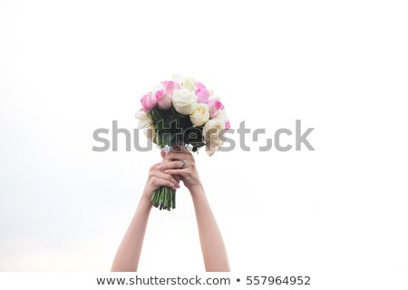 Caucasian bride tossing the bouquet of flowers. Stock photo © RAStudio
