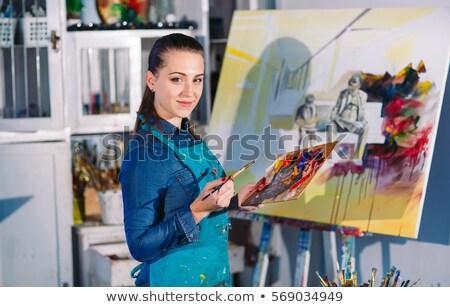 Fiatal nő tart vászon festőállvány lövés fiatal Stock fotó © deandrobot