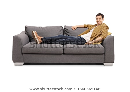 a man lying on sofa stock photo © is2