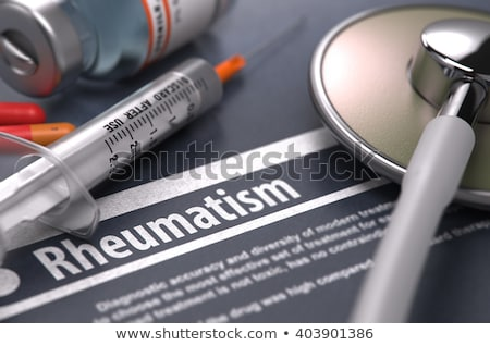 Rheumatism - Printed Diagnosis on Grey Background. Stock photo © tashatuvango
