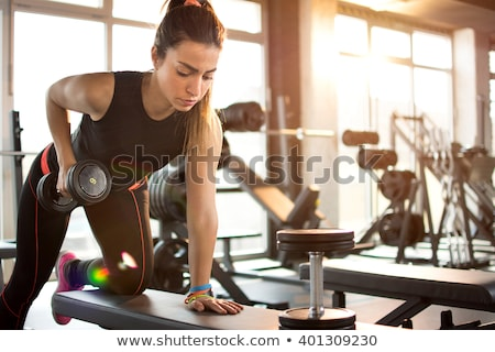 Sportive girl in gym stock photo © bezikus