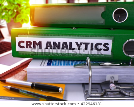Green Ring Binder with Inscription CRM Analytics. Stock photo © tashatuvango