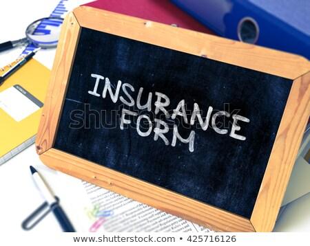 Insurance Form Handwritten on Chalkboard. Stock photo © tashatuvango