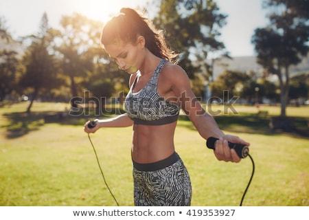 fiatal · sportos · nő · ugrik · kötél · képzés - stock fotó © dolgachov