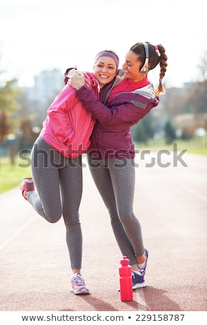 Femenino atletas sonriendo amistad activo Foto stock © IS2