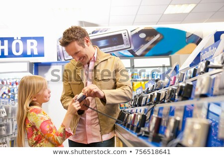 Girl begging her father for a camera Stock photo © IS2