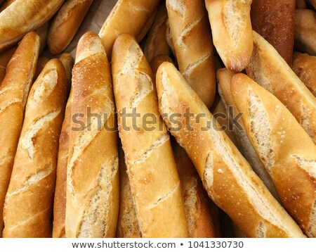 Stockfoto: Whole And Halved French Baguettes