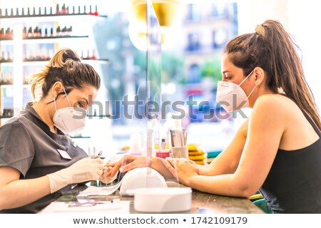 Beautician performing manicure Stock photo © IS2