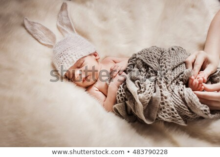 Toddler girl in a tiny room, looking at rabbit Stock photo © IS2