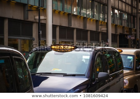 london taxis lined up on sidewalk stock photo © monkey_business