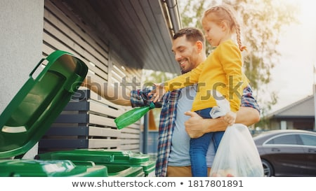 father helping young daughter recycle stock photo © is2