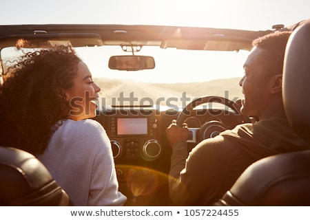 Back view of happy young couple pointing away Stock photo © deandrobot