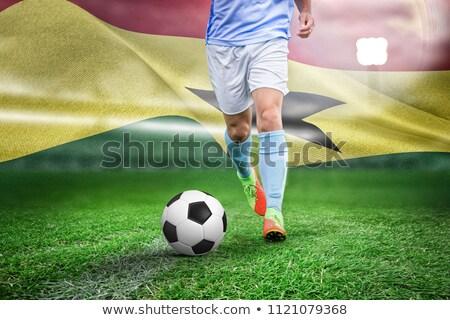 Male soccer player playing football against digitally generated ghana national flag Stock photo © wavebreak_media