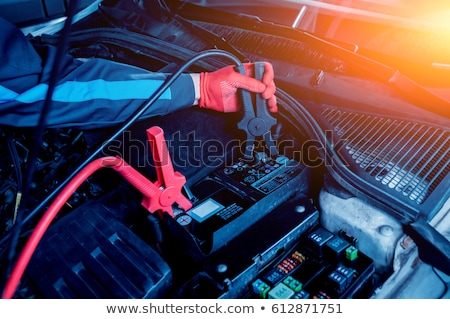 Car battery with two jumper cables Stock photo © fresh_7135215