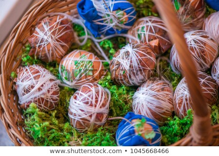 Easter eggs laying in wicker wooden basket  Stock photo © Valeriy