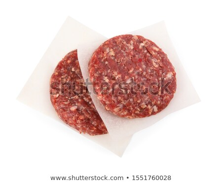 Raw beef patties on the white parchment Stock photo © Alex9500