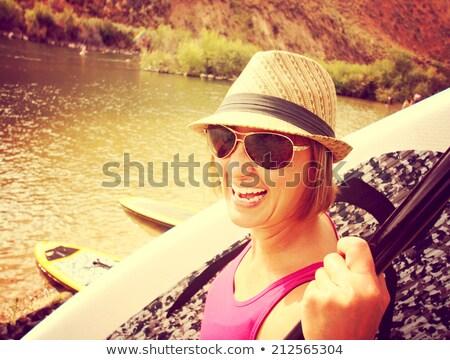 かなり 若い女性 搭乗 スタンド アップ ボード ストックフォト © lightpoet