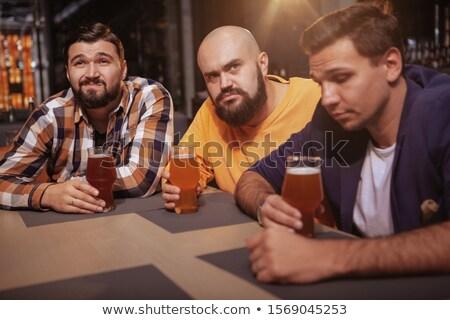 Amigos cerveza viendo fútbol juego ocio Foto stock © dolgachov