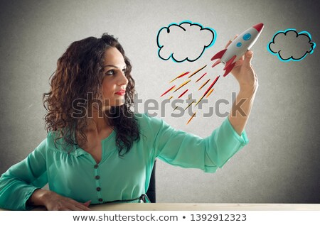 Businesswoman launches his company with a rocket. Concept of startup and innovation Stock photo © alphaspirit