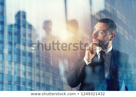 Businessman thinks new strategies to grow up the company Stock photo © alphaspirit