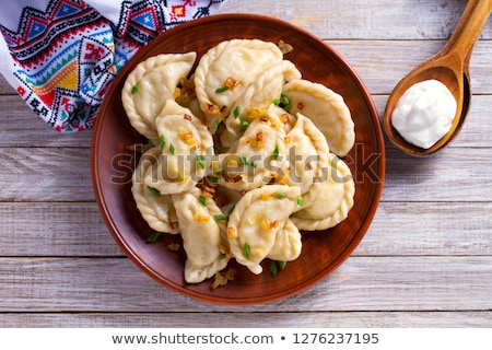 Polish pierogi filled with cabbage and mushrooms Stock photo © joannawnuk