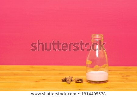 bottle half full of strawberry milkshake with cookie crumbs stock photo © sarahdoow