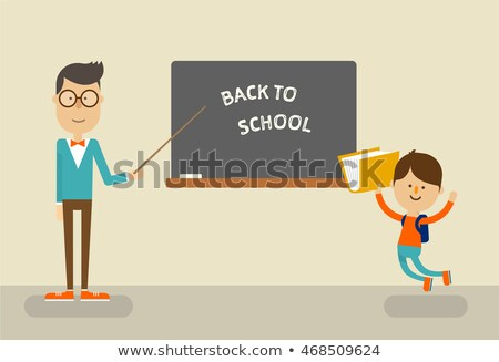 Teacher and students of primary school jumping in classroom Stock photo © Kzenon