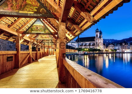 luzern evening view of famous landmarks and reuss river stock photo © xbrchx