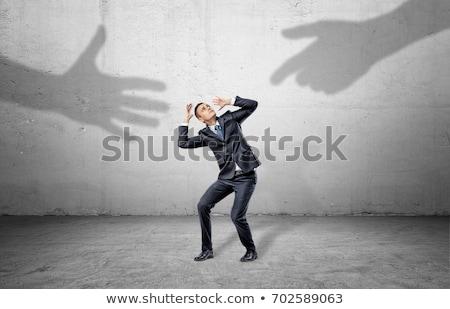 Giant businessman scared of small businessman Stock photo © ra2studio