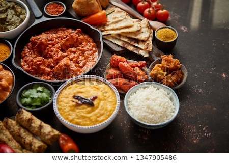 Assortment of various kinds of Indian cousine on dark rusty table Stock photo © dash