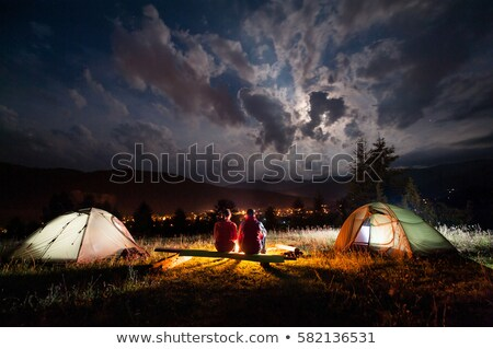 Camping People, Couple Sitting by Bonfire Together Stockfoto © robuart
