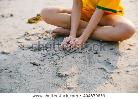 Kids building a sand castle with copy space Stock photo © ayelet_keshet