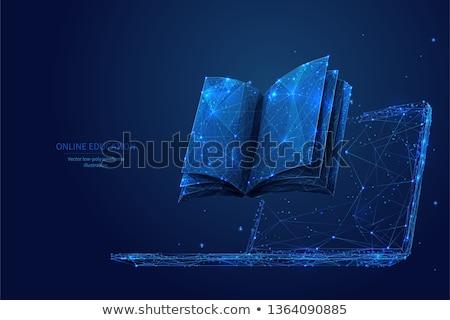 Boek laptop elektronische bibliotheek online onderwijs Stockfoto © studiostoks