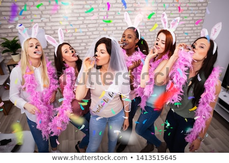 Women Drinking Tequila Shots Wearing Feather Boa And Hair Band Stock photo © AndreyPopov