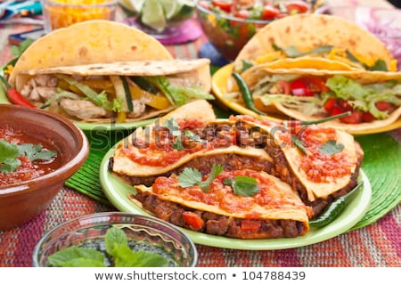 Tasty Mexican meat tacos served with various vegetables and salsa Stock photo © dash