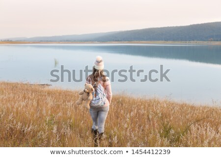 Woman in long soft grasses by lake Country Life Stock photo © lovleah