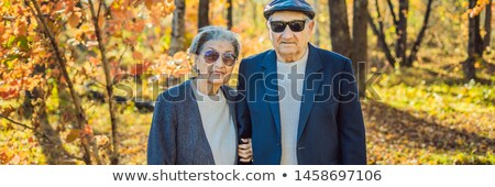 Stock photo: Pensioners in sunglasses in the autumn forest. Pensioners like gangsters