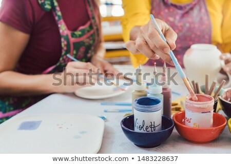 женщину ручной работы блюд щетка цвета краской Сток-фото © Kzenon