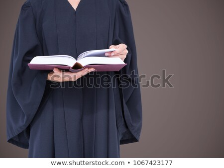 female judge mid section with open book against brown background stock photo © wavebreak_media