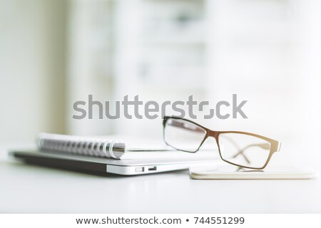 Close-up of spiral stack of books Stock photo © lichtmeister
