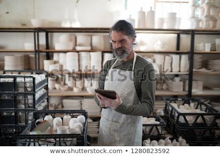 Odaklı tablet çalışmak çanak çömlek atölye iş Stok fotoğraf © wavebreak_media