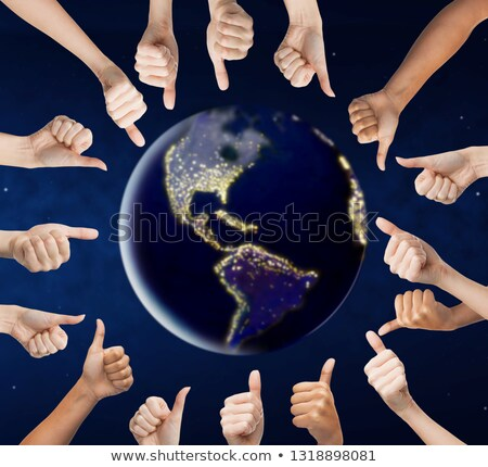 human hands showing thumbs up around earth planet stock photo © dolgachov