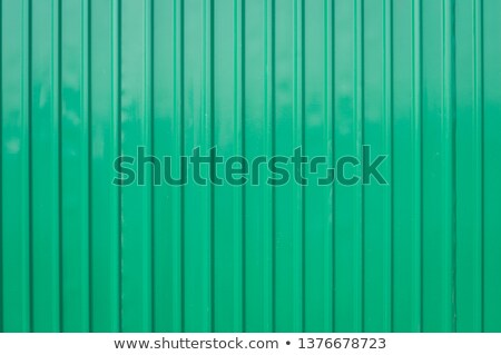 Siding green metal vertical panels texture Stock photo © boggy