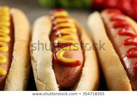 close up of hot dog on wooden table Stock photo © dolgachov