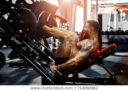 Uygun adam bacak basın makine sağlık Stok fotoğraf © Jasminko