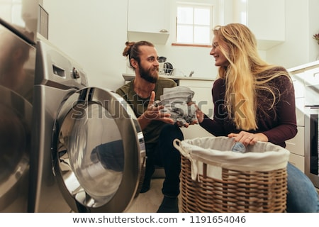 man putting clothes into the washing machine Stock photo © nito