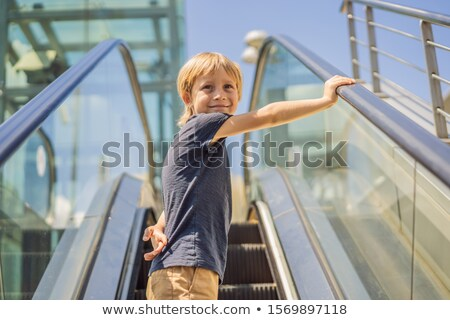 мало мальчика эскалатор Mall Открытый портрет Сток-фото © galitskaya