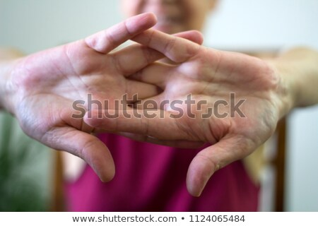 Woman Cracking Knuckles Stock photo © AndreyPopov
