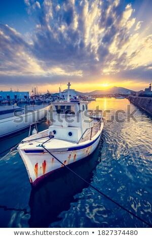 Old fishing boat in port of Naousa on sunset. Paros lsland, Greece Stock photo © dmitry_rukhlenko