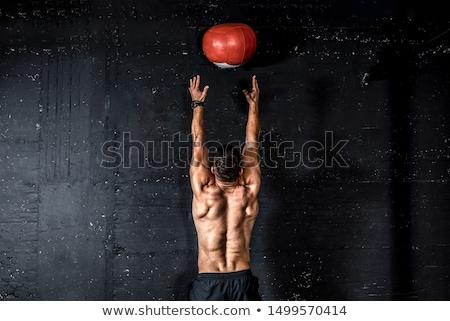 Sportowiec trening siłowy muzyka piłka kulturysta piersi Zdjęcia stock © Maridav